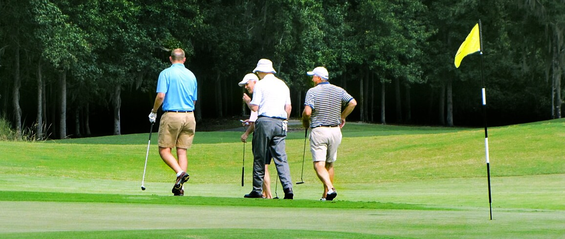Four men walking on golf course in Port Wentworth Georgia